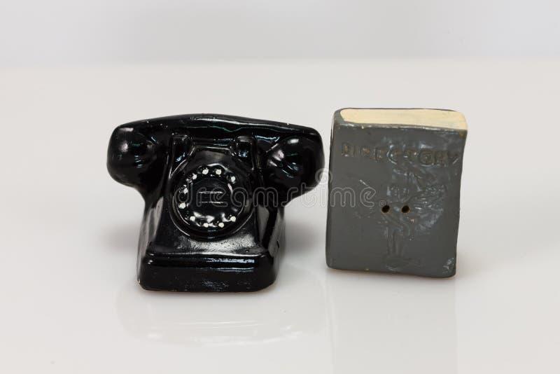 Abanadores telefone e de sal e de pimenta giratórios do diretório imagens de stock royalty free