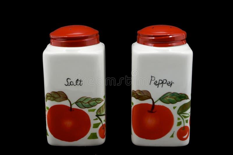 Abanadores vermelhos de sal e de pimenta do tampão fotografia de stock