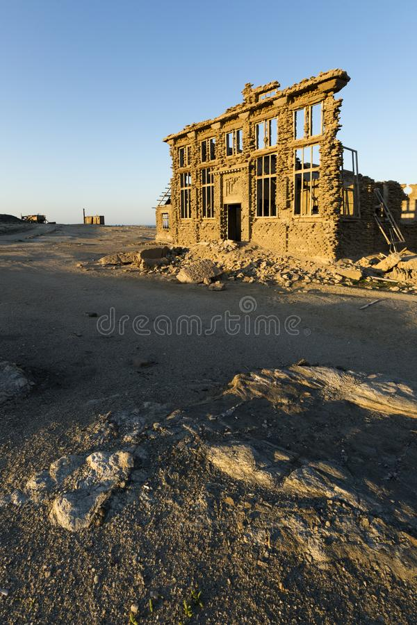 Abandon building at sunrise. Namibia royalty free stock photos
