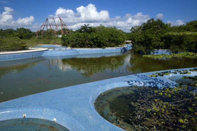Abandon swimming pool and hot tubs. Full of rain water serve as the perfect environment for mosquitoes to breed and the spread of diseases like Zika, Malaria stock photos