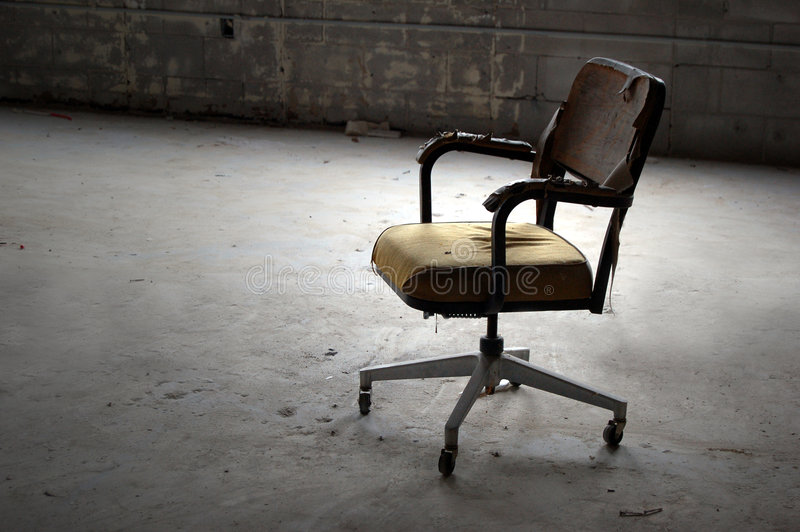 Abandoned. Old office chair found in an abandoned building royalty free stock photo