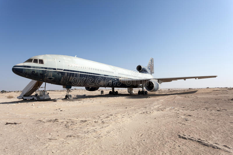 Abandoned airplane in the desert. ABU DHABI - DEC 22: Airplane in the desert at the Emirates National Auto Museum in Abu Dhabi. December 22, 2014 in Abu Dhabi stock images