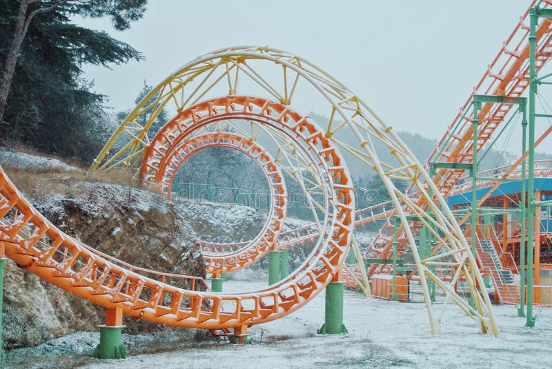 Abandoned amusement theme park covered with falling snow on a co royalty free stock photos