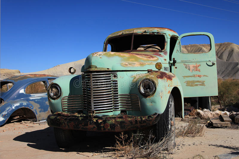 Abandoned antic old truck. Classic car, age automobile, forgotten rusty vehicle, broken headlight, front grille, broken headlight, lorry stock photography