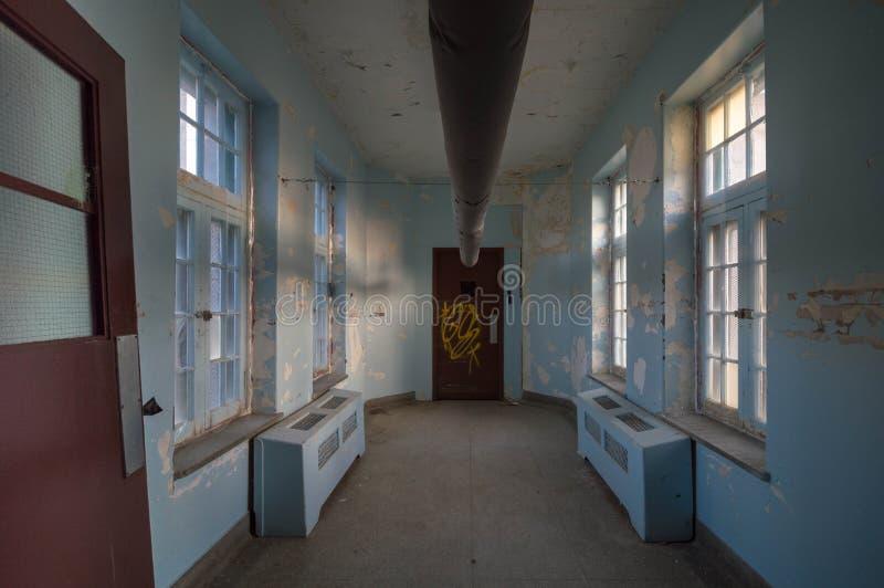 Abandoned Asylum for the Criminally Insane Urban Exploring royalty free stock photo