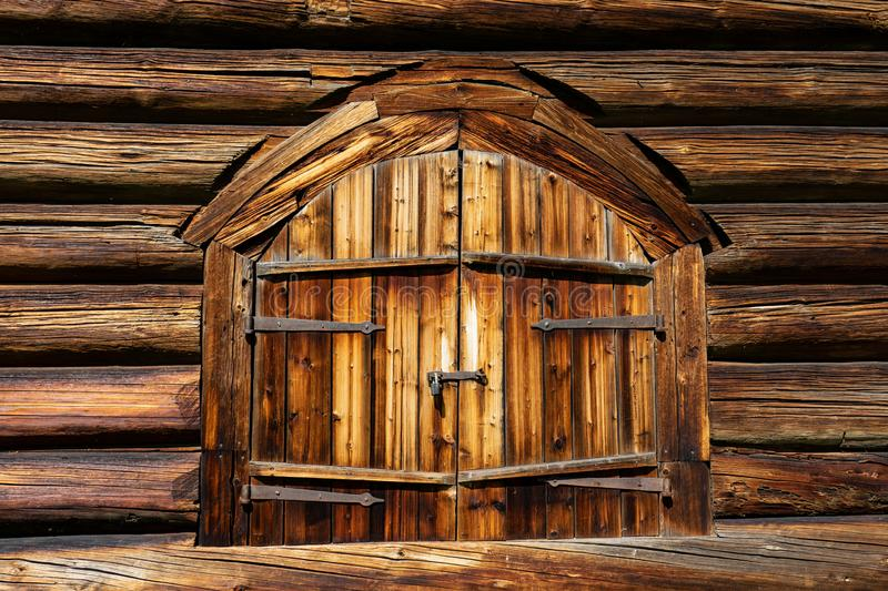 Abandoned barn vintage wooden door. Old photo of rustic house entrance. Abandoned barn antique wooden door. Old photo of the entrance to the village house. Log stock image