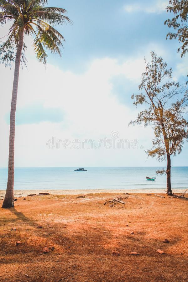 Abandoned beach with fisher boat on ocean, Vietnam stock images