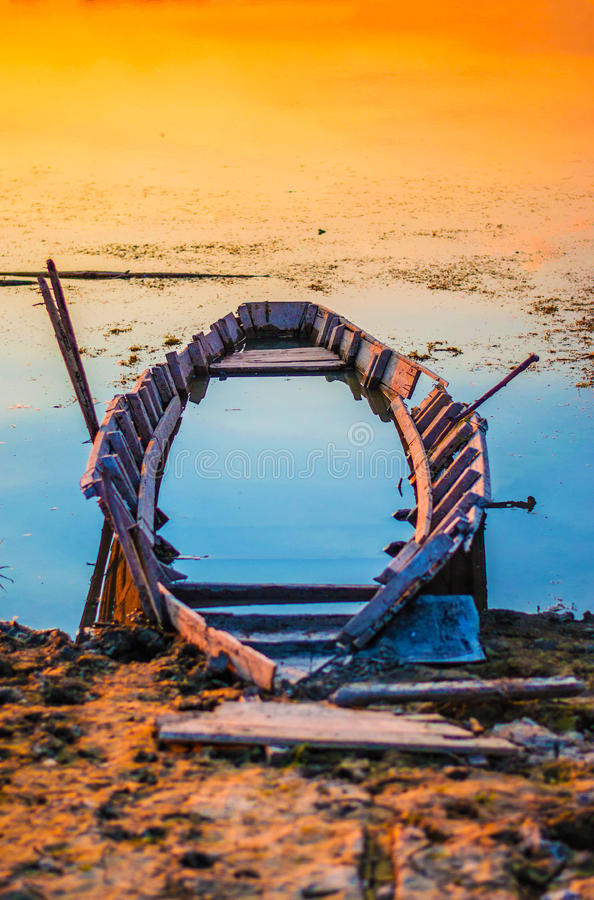 Abandoned Boat Photographed at Sunset royalty free stock photography