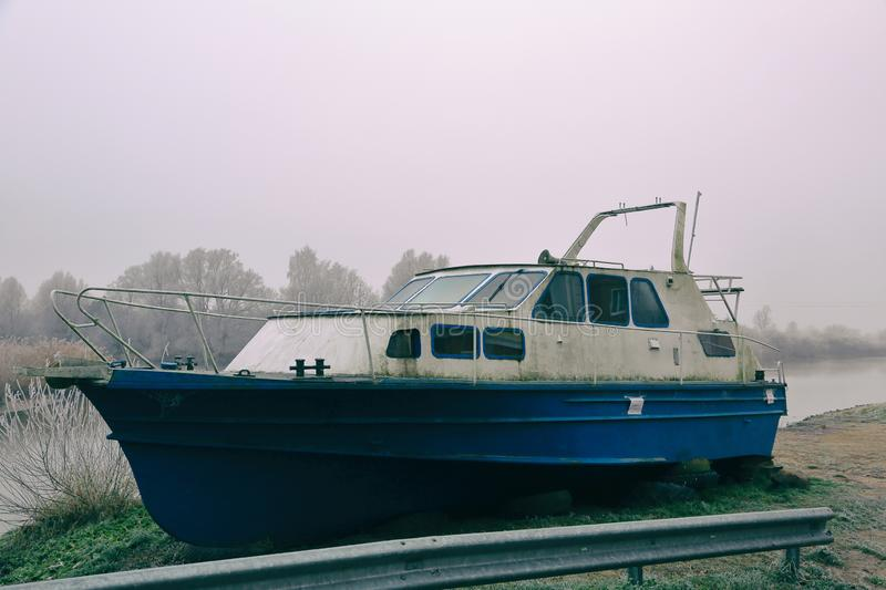 Abandoned boat on the shore stock photography