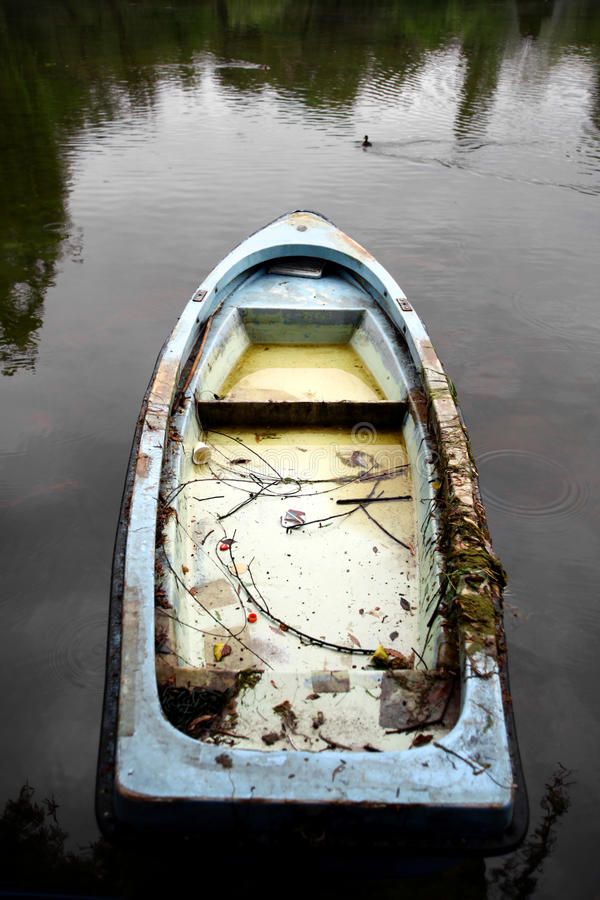 Abandoned boat. An abandoned boat on the shores of a lake stock photo