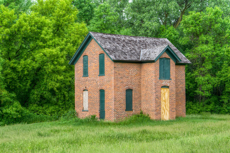 Abandoned Brick Farmhouse in the United States. Midwest stock photography