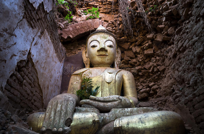 Abandoned buddha. Statue in cave, Inle lake, Myanmar royalty free stock images
