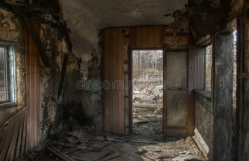 Abandoned building. Interior room with windows and door of an abandoned building in disrepair royalty free stock photo