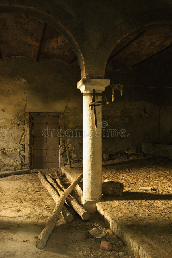 Abandoned building with column and arch. royalty free stock images