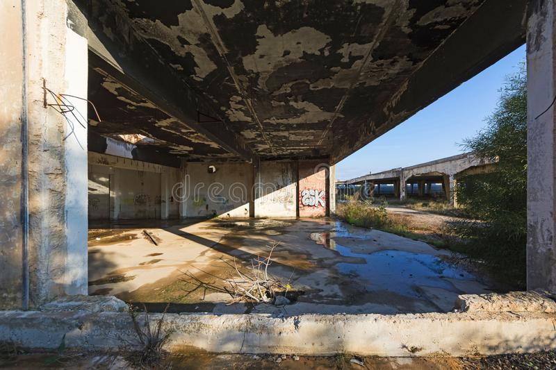 Abandoned building. Damaged industrial facilities royalty free stock images
