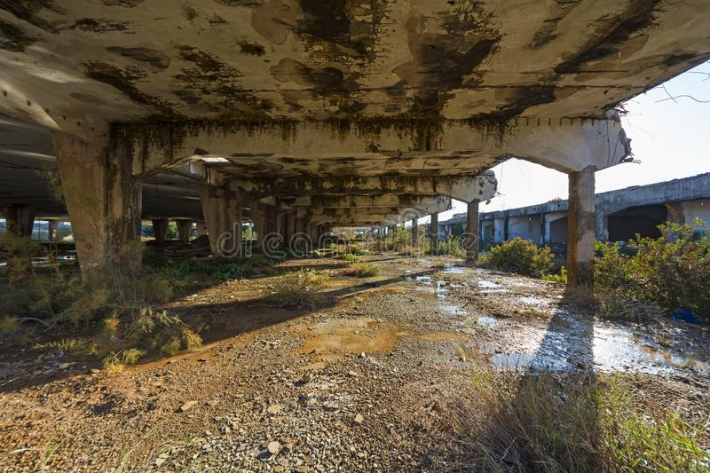 Abandoned building. Damaged industrial facilities royalty free stock photo