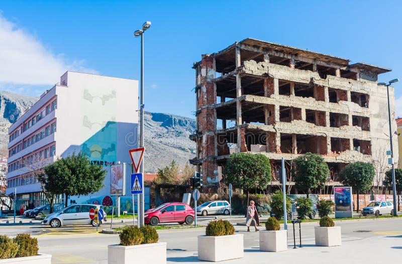 Abandoned building, detroyed during Bosnian War at Bulevar Street in Mostar city, Bosnia and Herzegovina. View of Abandoned building, detroyed during Bosnian War royalty free stock images