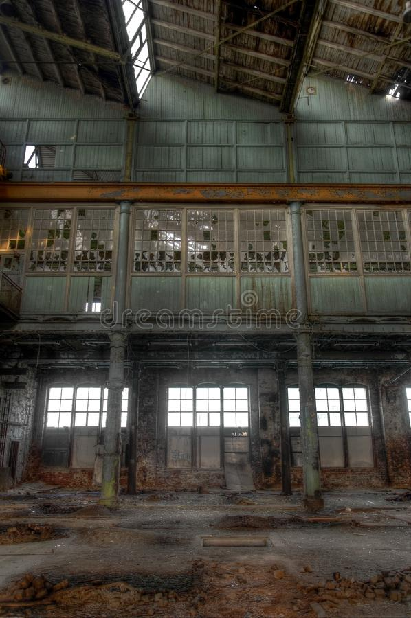 Abandoned building in a factory. View on a second floor of an abandoned manufacturing facility stock photos