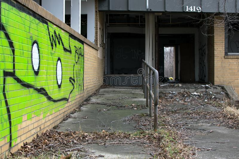 Urban art on abandoned buildings. Abandoned building in flint Michigan with urban art graffiti on the walls stock images