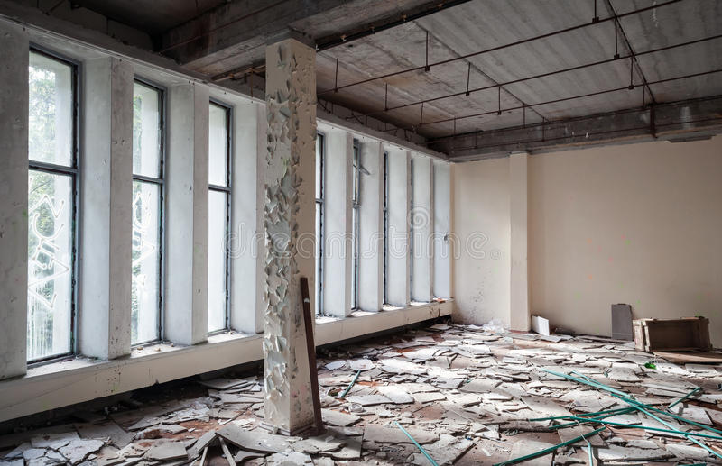 Abandoned building interior. Old concrete walls. Abandoned industrial building interior. Concrete walls and columns royalty free stock photography