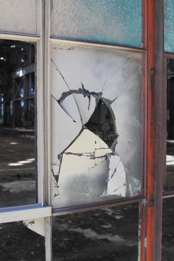 Broken and cracked industrial windows in metal frames royalty free stock photos