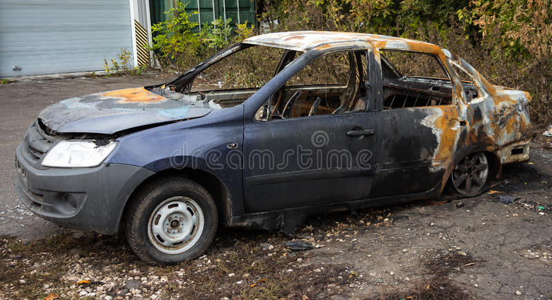 Abandoned Burnt Car 2. Abandoned Burnt Car. The car stands in front of thickets of bushes royalty free stock images