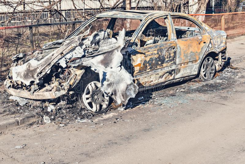 Abandoned and burnt-out car. stock photography