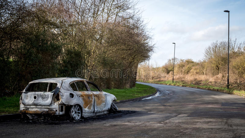 Abandoned and burnt-out car royalty free stock images