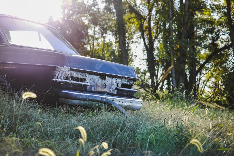 Abandoned Car Sitting in a Meadow stock photography