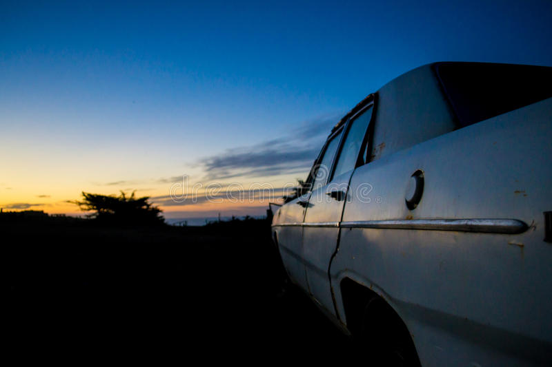 Download Abandoned Car In The Twilight Stock Photo - Image of purple, sunlight: 92418604