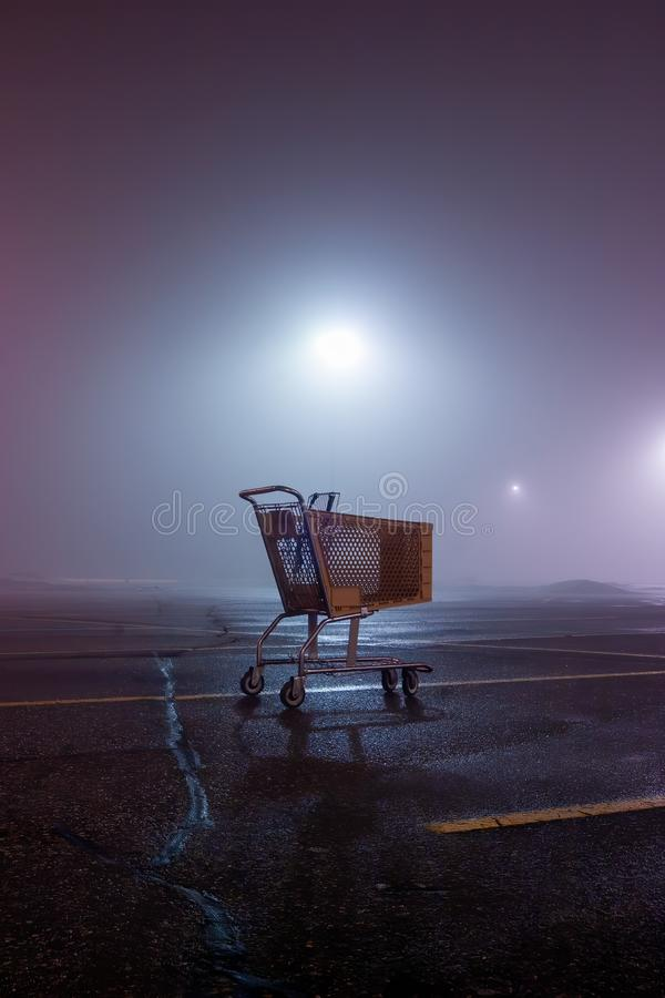Abandoned Cart in parking lot royalty free stock photography