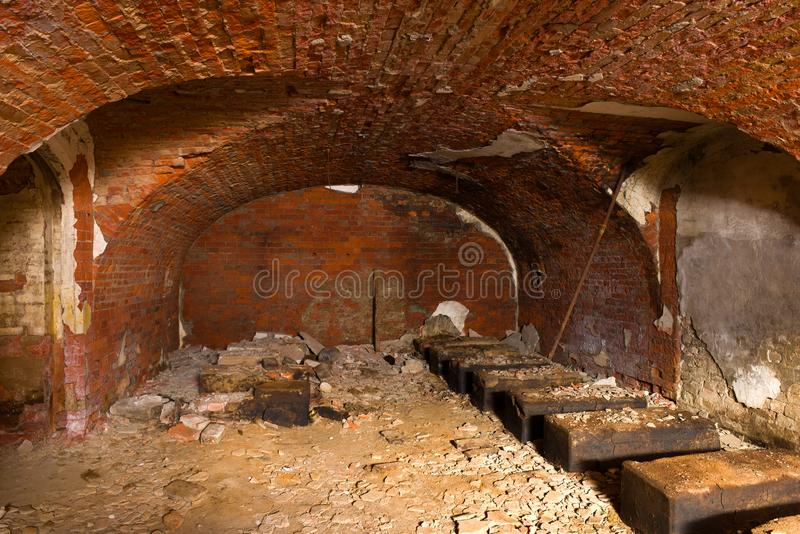 Abandoned casemate for storing artillery shells of the old naval fort Zverev. Kronstadt, Russia. Abandoned casemate for storing artillery shells of the old naval royalty free stock photography