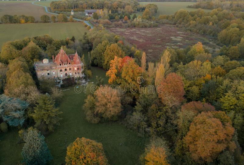Abandoned castle in the countryside during Autumn. Aerial shot of Abandoned French castle in the countryside during Autumn taken from a DJI Mavic Pro Drone stock photos