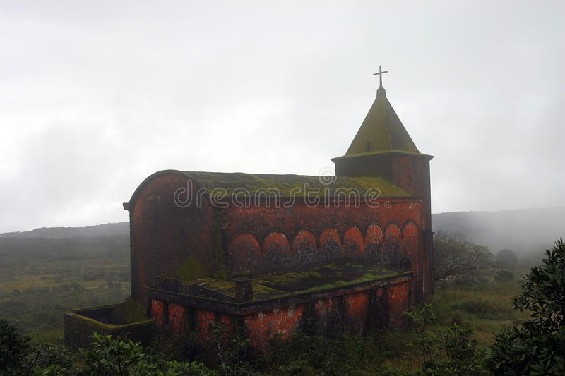 Abandoned Church. Bokor Hill, Kampot. Cambodia. Abandoned church in foggy weather. 'Ghost town' Bokor Hill station near town of Kampot. Cambodia royalty free stock photography