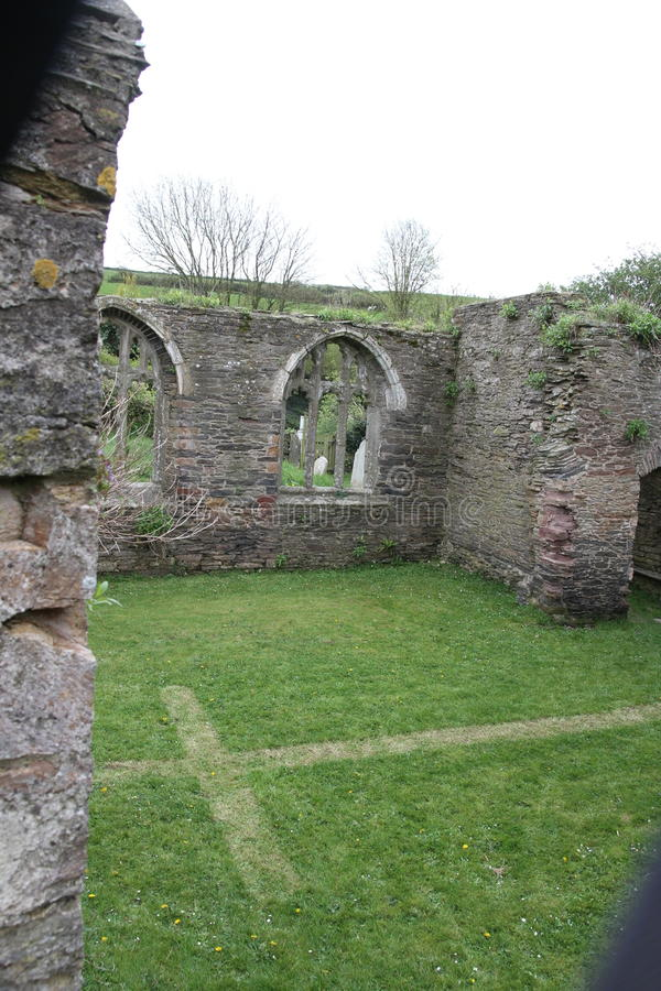 Abandoned church in South Huish, Devon. With cross mown into the grass inside what was the church nave royalty free stock photos