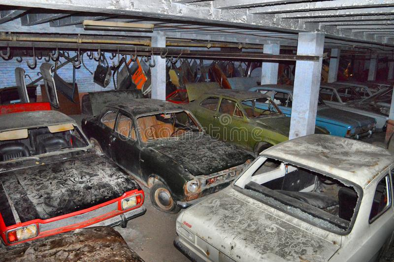 Abandoned cars in a car garage. Abandoned classic cars lined up in a car garage in Belgium, Europe royalty free stock photos