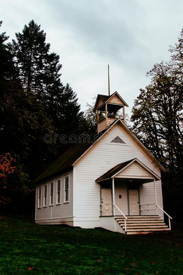 Abandoned closed wooden church in a forest in the countryside stock image
