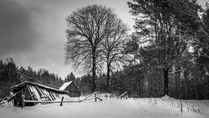 Abandoned country house in snow stock images
