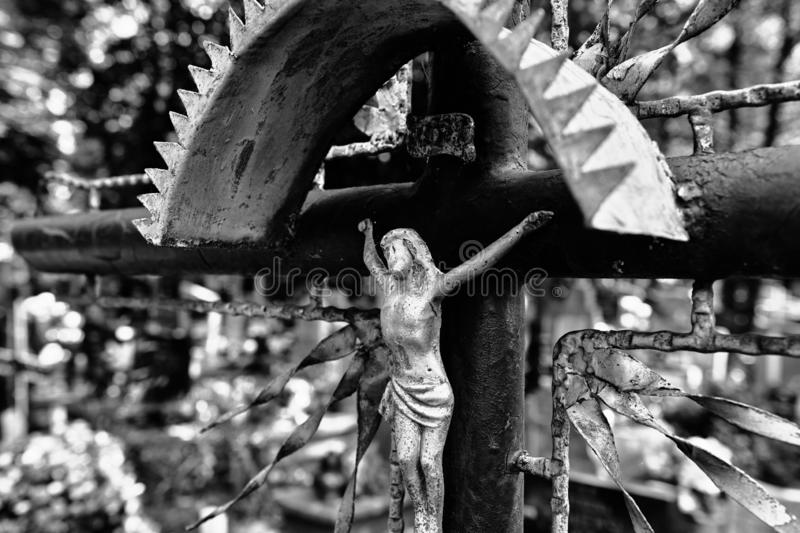 Abandoned cross on the cemetery stock photography