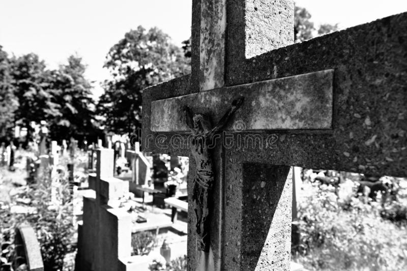 Abandoned cross on the cemetery royalty free stock images