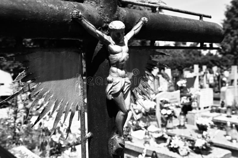 Abandoned cross on the cemetery stock photos