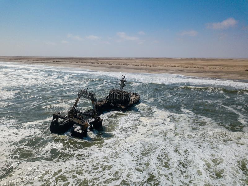 Abandoned and derelict old shipwreck Zeila at the Atlantic Coast near Swakopmund and famous Skeleton Coast in Namibia. Africa. Group of cormorants birds stock photography