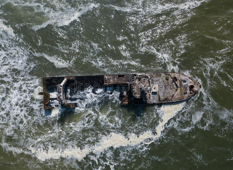 Abandoned and derelict old shipwreck Zeila at the Atlantic Coast near Swakopmund and famous Skeleton Coast in Namibia. Africa. Group of cormorants birds royalty free stock photography