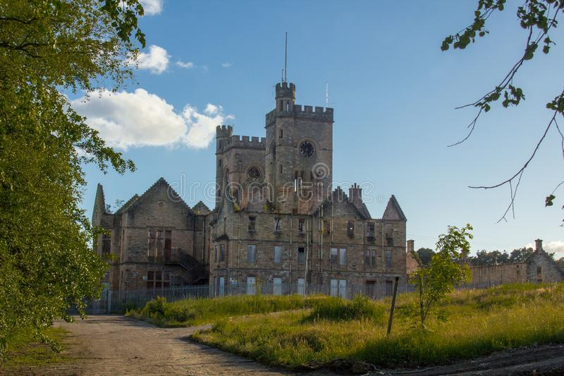 Hartwood Hospital Church with  imposing twin clock towers. Lanarkshire, Scotland. Abandoned derelict of 19th centrury baronial style Hartwood Hospital Church stock photo
