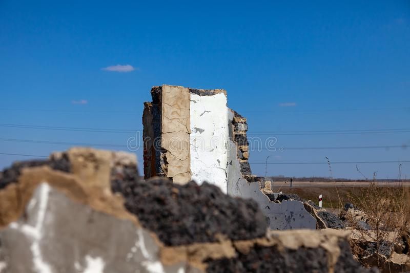 Abandoned and destroyed building from which only the wall remains and the roofless walls with rubbish and construction debris. The stock images