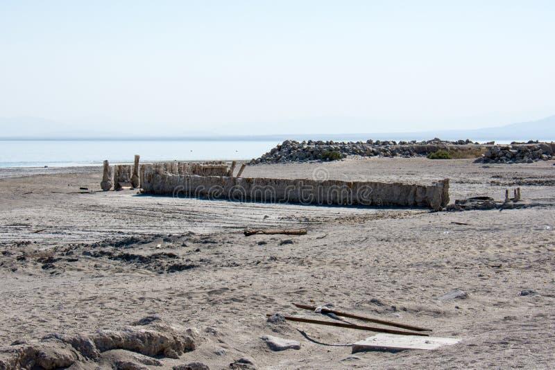 Abandoned dirty shoreline of the Salton Sea in Bombay Beach California on a sunny day royalty free stock photo