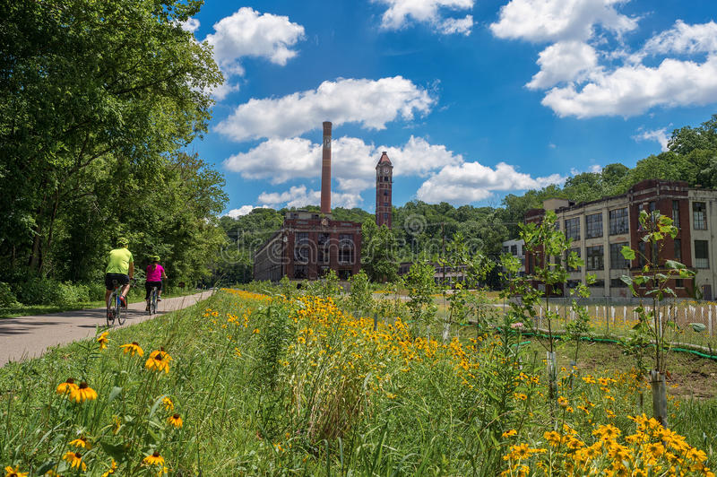 Abandoned factory along Little Miami Scenic Trail. The bike trail in King Mills, Ohio, where it passes the remains of the Peter Cartridge Company factory where royalty free stock photo