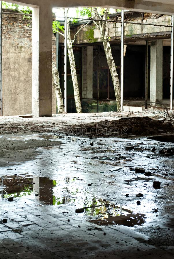 Abandoned factory building from the inside, the ruins of the wall. Broken windows, rust, unfinished royalty free stock photo