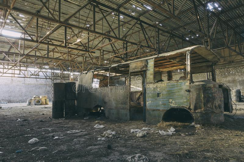 Abandoned factory hangar, where games are held in paintball. Travel stock photo
