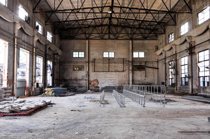 Abandoned factory interior. Abandoned Industrial building, Old damaged factory warehouse stock photo